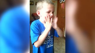 A Young Boy Eats A Piece Of Warhead Candy For The First Time