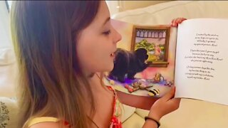 Little girl promotes her new Children's Book based on her beloved pet
