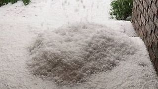 Huge Pile of Hail Builds Up Outside House in Greeley, Colorado - Video