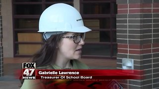 Lansing school board holds meeting at construction site for new high school