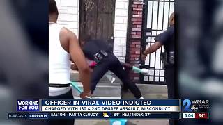 Baltimore officer seen in viral punching video charged