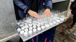 Street Performer Plays Harry Potter's Theme Song On Glass Harp - Video