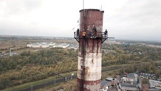 Daredevils rope swing from 328 foot chimney at closed power plant