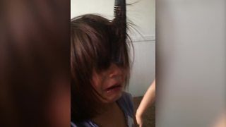 """""""A Young Girl Cries Because A Comb Is Stuck in Her Hair"""""""
