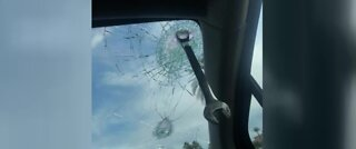 Wrench slams through woman's windshield