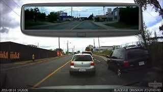 Car Passes on the Inside and Continues Driving on Sidewalk - Video