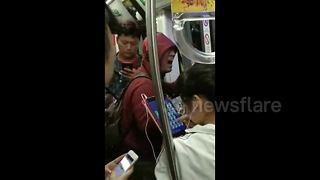 Man breaks out into song on Beijing subway - Video