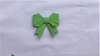 Origami magic: How to make a paper bow - Video