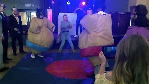 Newlyweds Wrestle In Sumo Suits For First Dance In Hilarious Video Clip