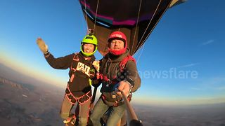 Couple celebrates Valentine's Day be leaping from hot air balloon - Video