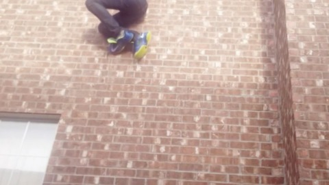 Bad Idea: Guy Climbs Out Window Using Shoelaces