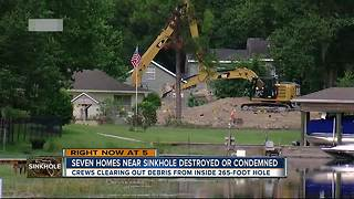 Seven homes near sinkhole destroyed or condemned - Video