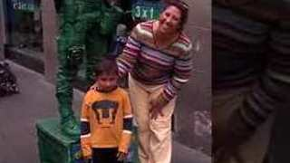 Funny Toy Story Soldier Street Performer Plays with a Kid - Video