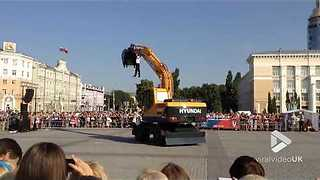 French Dancer Performs Ballet With An Earth Digger - Video