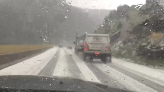 Heavy Hail Covers Colorado Highway - Video