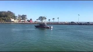 Rescue underway for car that drove into water | Digital Short