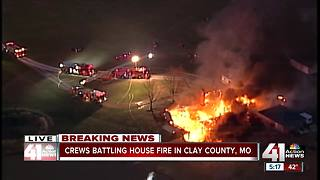 Crews battle large house fire in rural Clay County - Video