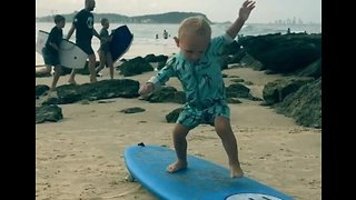 Cute Toddler Practices His Surfing Moves on Dry Land - Video
