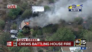 House fire spreads to nearby brush in Cave Creek - Video