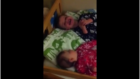 Little boy sends baby brother into laughing fit