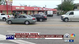 Man shot woman outside grocery store - Video