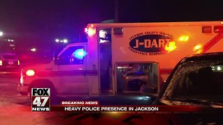 Officer and suspect exchange gunfire in Jackson