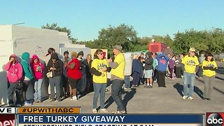 Long line for free Thanksgiving turkeys at Steinbrenner Field