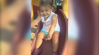 """Toddler Girl Gets Stuck on Playground Slide"""