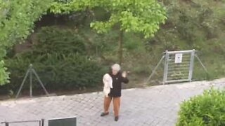 Lady takes her dog for a dance