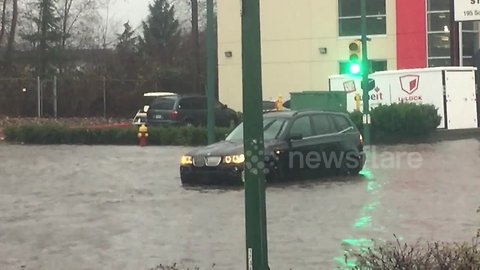 Cars stranded on flooded streets after heavy downpour inundates Metro Vancouver