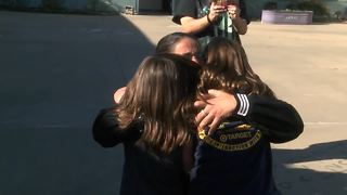 Mother returns from deployment, surprises kids