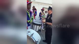 NYPD officer in drum battle with Jamaican marching band - Video