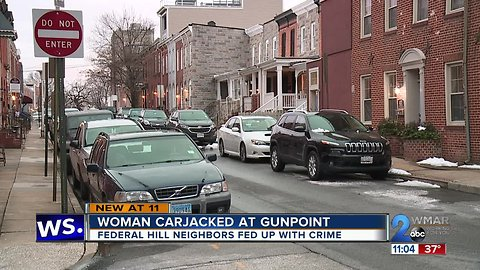 Woman carjacked at gunpoint in Federal Hill