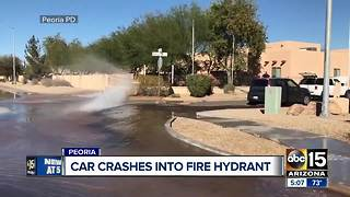 Car crashes into fire hydrant in Peoria