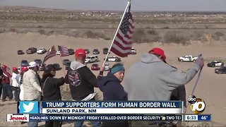 Trump supporters form human wall