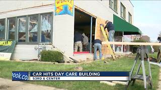 Police: Nobody hurt after car drives into Milwaukee day care building - Video