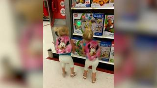 """""""Twin Girls Dancing Adorably in Toy Store"""""""