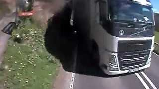 Driver Has Near-Death Experience With Oncoming Truck - Video