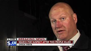 Search for suspect after two people killed - Video