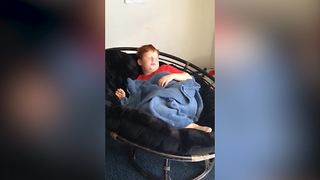 Young Boy Falls Off A Chair While Sleeping - Video