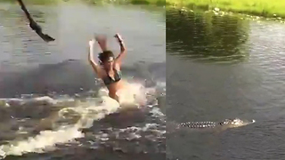 Kids Swing and Jump Into River With Crocodile in It - Video