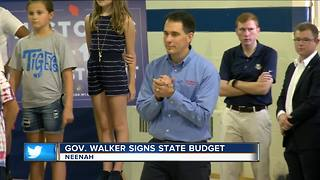 Governor Walker signs $76 billion state budget into law nearly three months late - Video