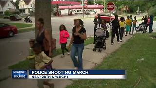 Community members, police march in honor of fallen officer - Video