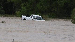 Truck swept down stream in Columbia, South Carolina