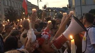 Polish Demonstrators Sing, Protesting Changes to Judiciary Branch Outside Warsaw Palace - Video