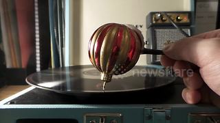 Christmas bauble plays festive record - Video