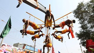 Worshippers display their devotion by piercing skin with metal hooks during hindu festival - Video