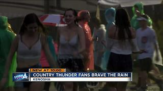 Country Thunder plays on despite heavy rains and flood threat - Video