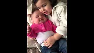 Big Sister Stops Baby From Crying By Singing To Her - Video
