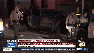 3 children hurt after mom crashes truck into wall - Video